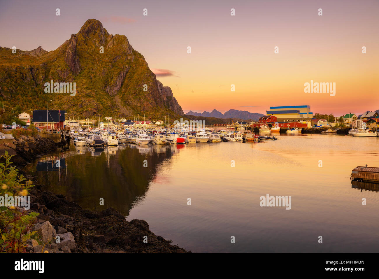 Many yachts anchored at the Marina of Svolvaer on Lofoten islands - Stock Image