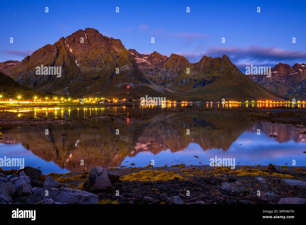 Evening at a fishing village on Lofoten islands in Norway  - Stock Image