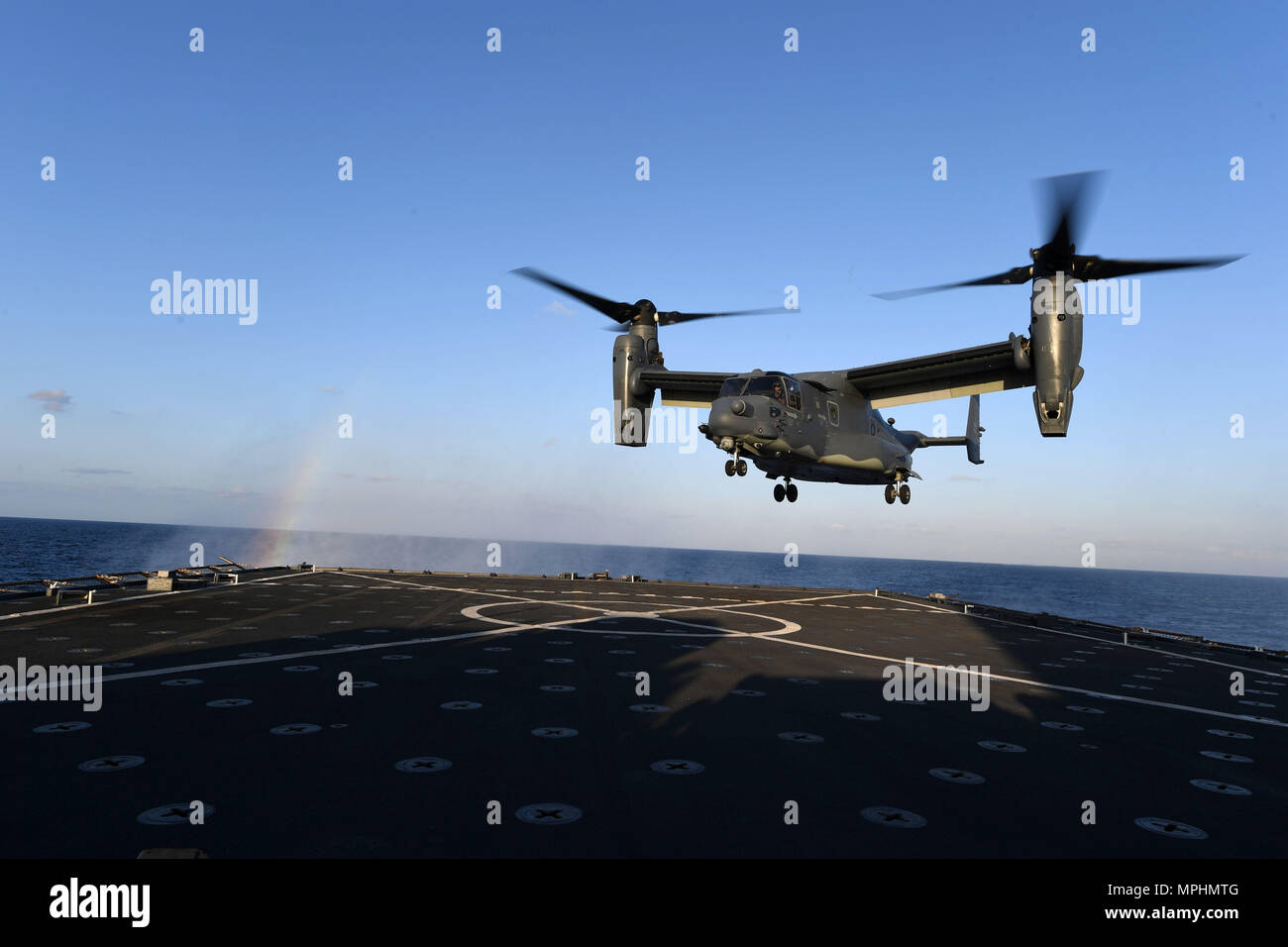 170313-N-ME988-969 MEDITERRANEAN SEA (March 13, 2017) A CV-22 Osprey assigned to Special Operations Command Europe  approaches the flight deck of the amphibious dock landing ship USS Carter Hall (LSD 50) during deck landing qualifications, March 13, 2017. The ship is deployed with the Bataan Amphibious Ready Group to support maritime security operations and theater security cooperation efforts in the U.S. 6th Fleet area of operations. (U.S. Navy photo by Mass Communication Specialist 1st Class Darren M. Moore/Released) Stock Photo