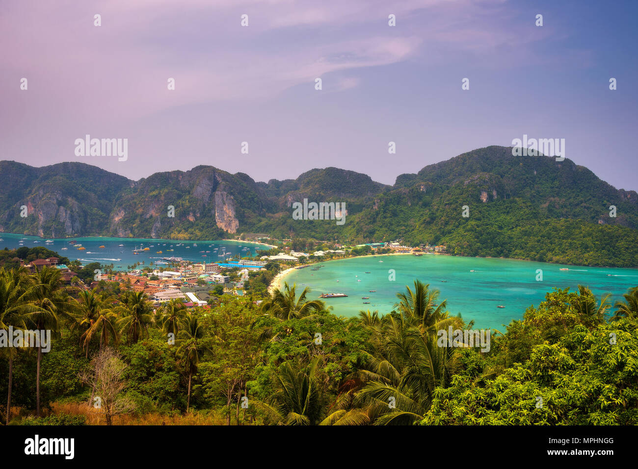 Tonsai Village and the mountains of Koh Phi Phi island in Thailand - Stock Image