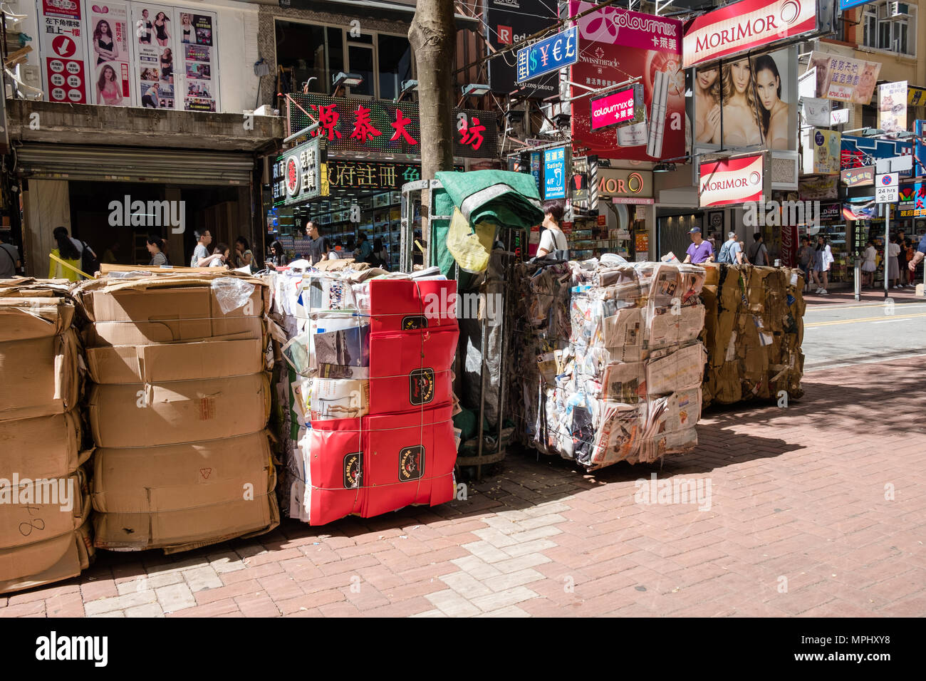 Office waste paper, old newspapers, cardboard packed for recycling. Urban scene. Environmental conservation concept. Hong Kong. - Stock Image