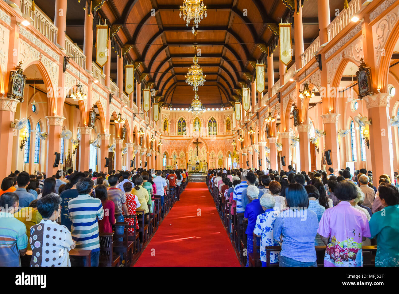 Chantaburi, Thailand - January 1, 2016: Group of pastors doing religion ceremony  while Chistian people standing to attend religion ceremony in occasi - Stock Image