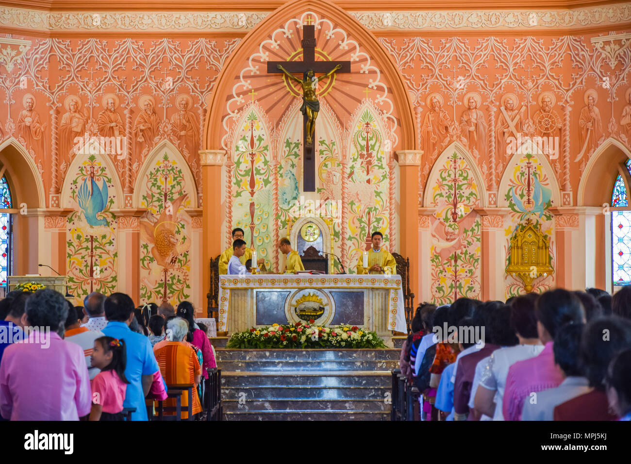 Chantaburi, Thailand - January 1, 2016: Group of pastors doing religion ceremony  while Christian people standing to attend religion ceremony in occas - Stock Image