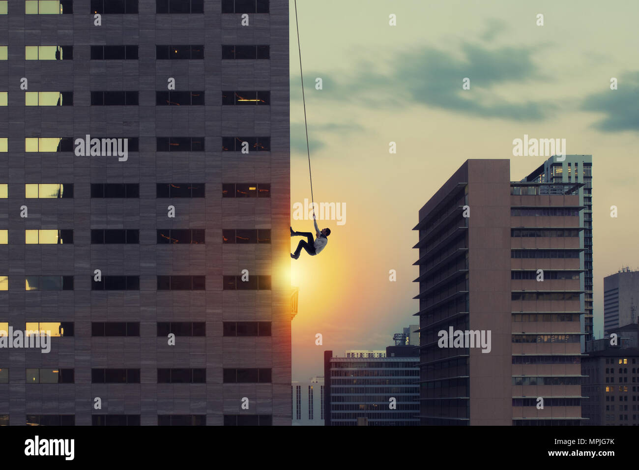 Businessman climb a skyscraper. Achievement business goal and difficult career concept - Stock Image