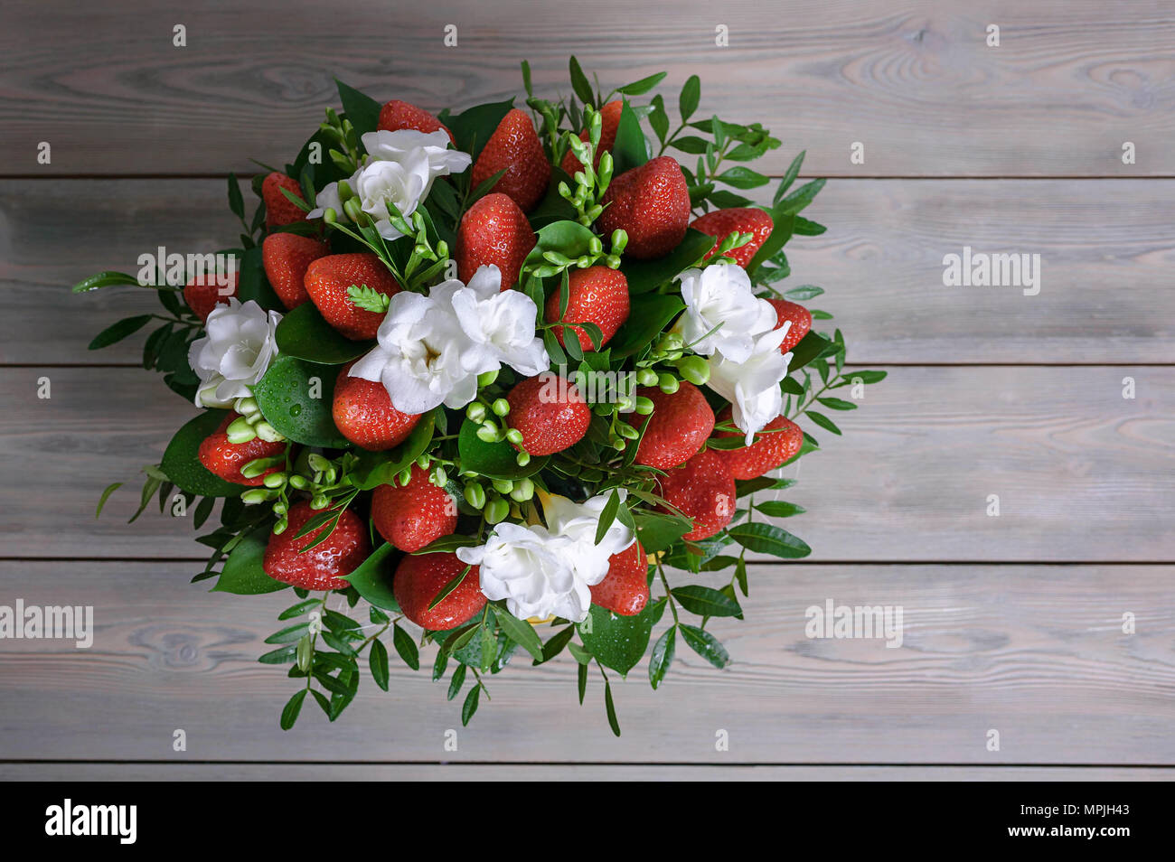 Bouquet From Flowers And Fruit Ripe Strawberry And White Freesia