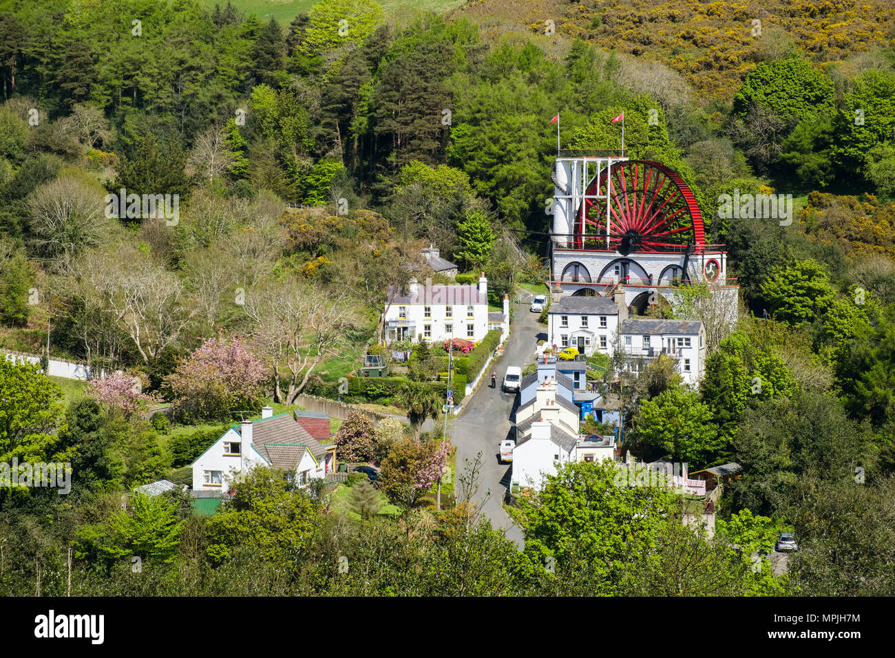 High view of Great Laxey Wheel and houses. Laxey, Isle of Man, British Isles Stock Photo