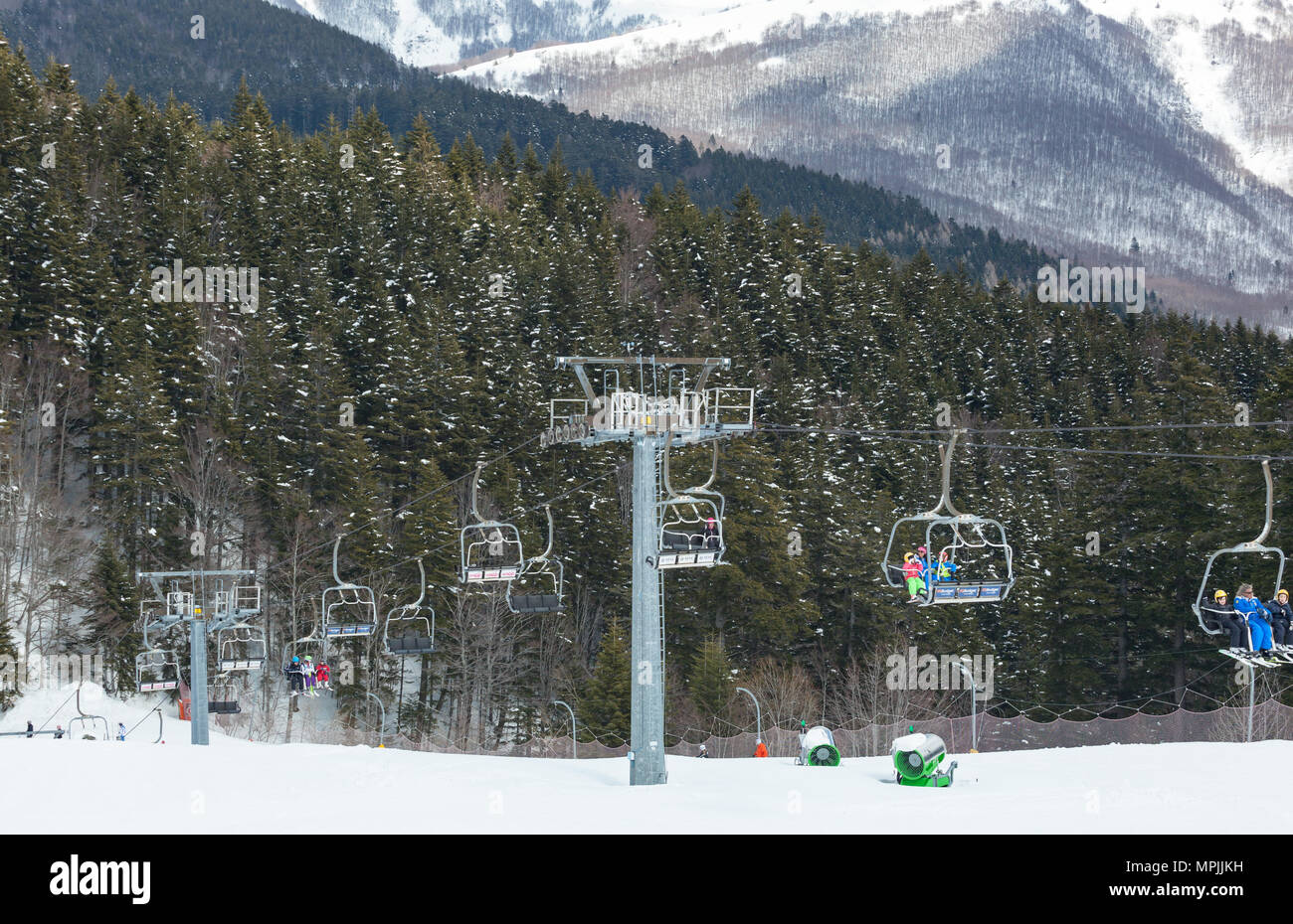 Chair Lift On Over The Snowy Forest At Abetone Italy Stock Photo Alamy