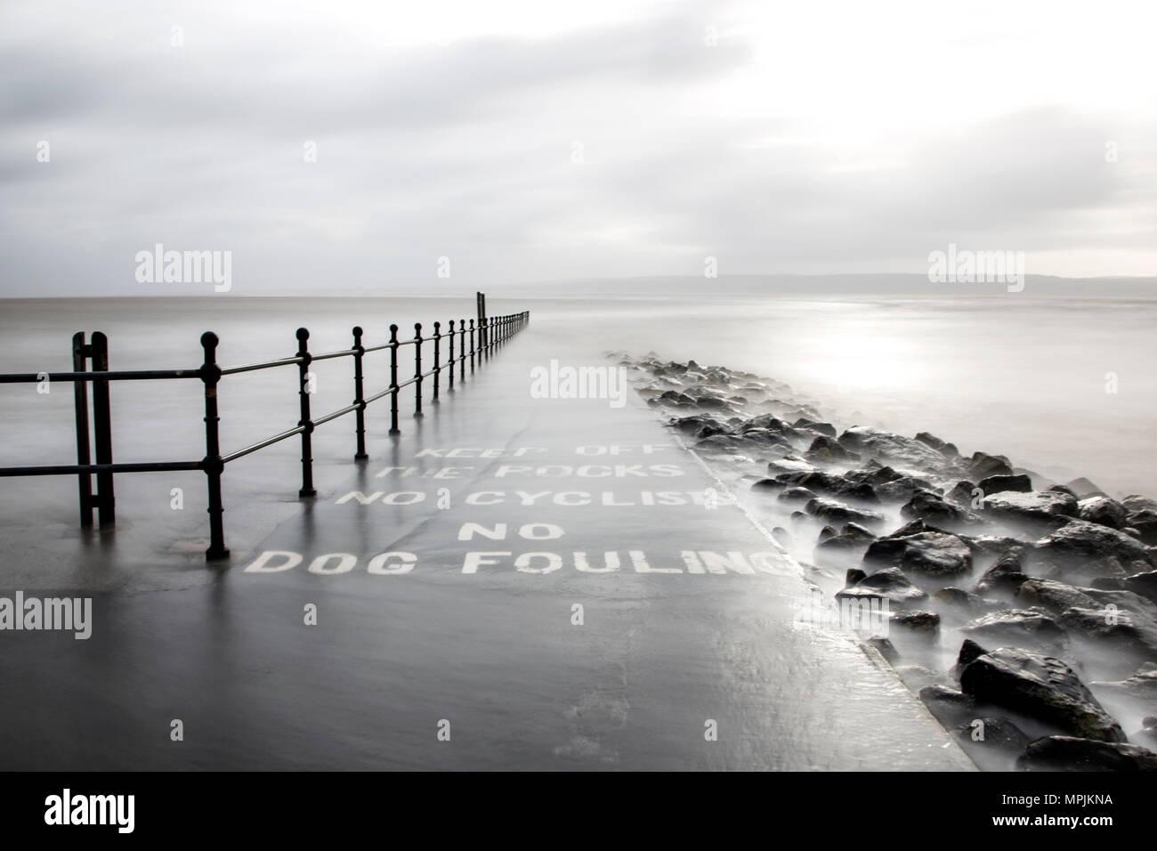 Marine lake pathway into the stormy sea. - Stock Image