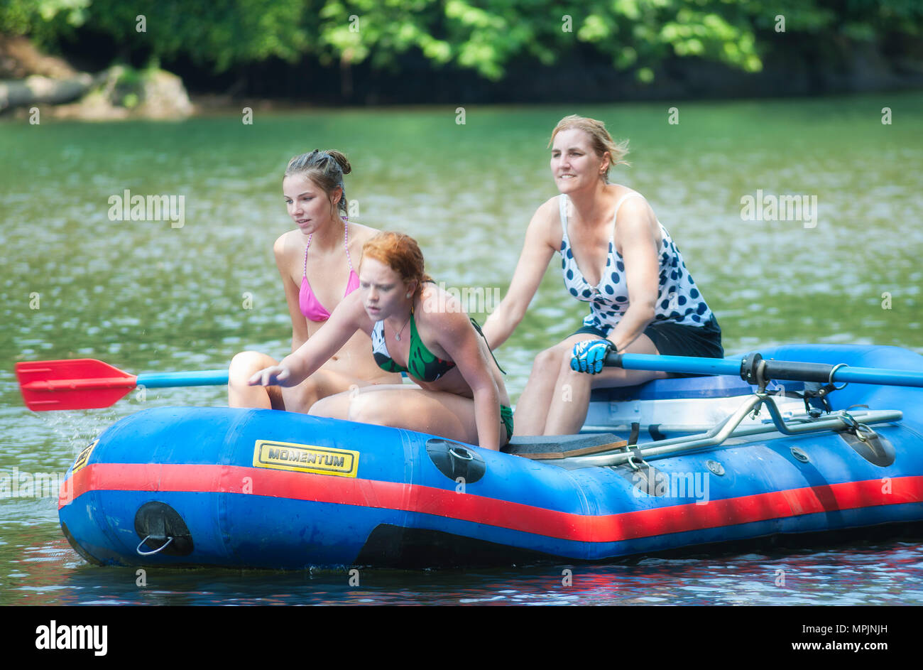 Carver, Oregon,USA - July 30, 2009:Three women in a raft floating down the Clackamas River near Carver, Oregon.  A popular summer water sport. - Stock Image