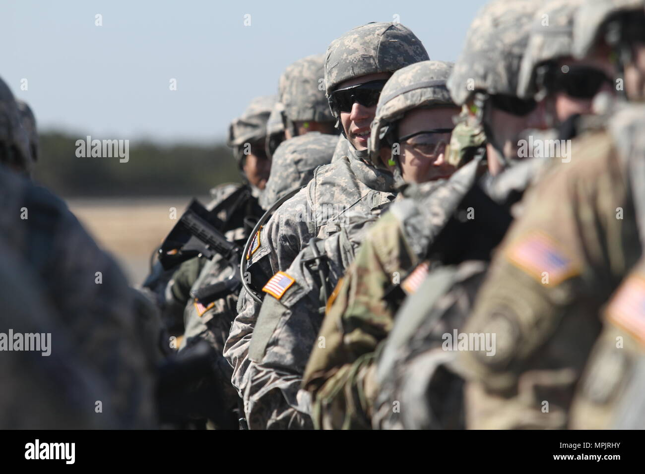 Soldiers from the 340th Military Police Company march forward on the