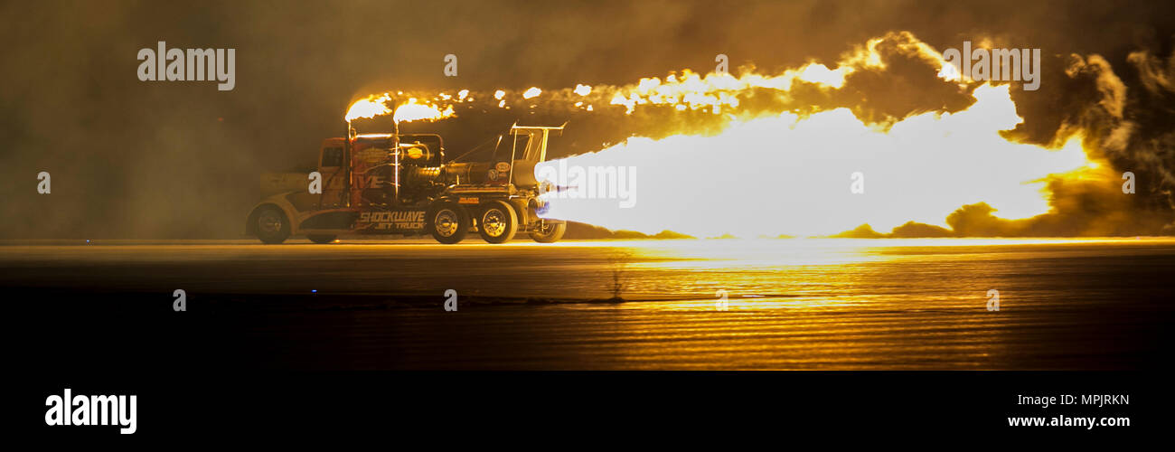 The Shockwave Jet Truck makes a high speed pass down the flight line using its jet propulsion system during the 2017 Twilight Show, Friday, March 17, 2017 at Marine Corps Air Station Yuma, Ariz. (U.S. Marine Corps photo taken by Lance Cpl. Isaac Martinez) - Stock Image