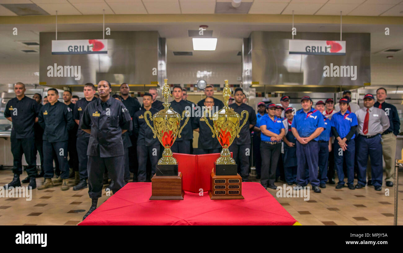 Semiannual Marine and Mess Attendant Award and trophies are displayed during an award ceremony for best full food service mess hall in the Marine Corps, Camp Lejeune, N.C., March 14, 2017. The mess halls were judged on factors such as cleanliness, recipe compliance, quality of food, teamwork, execution and training. (U.S. Marine Corps photo by Lance Cpl. Ashley D. Gomez) - Stock Image