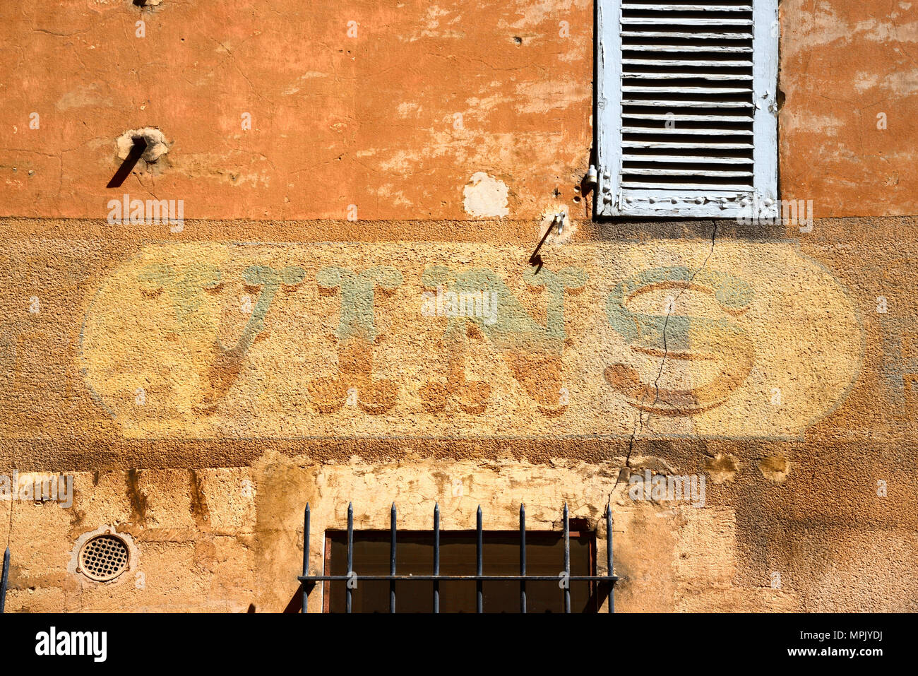 Old Wine Advert, Shop Sign or Faded Wall Painting of Former Corner Shop in the Old Town Aix-en-Provence Provence France - Stock Image