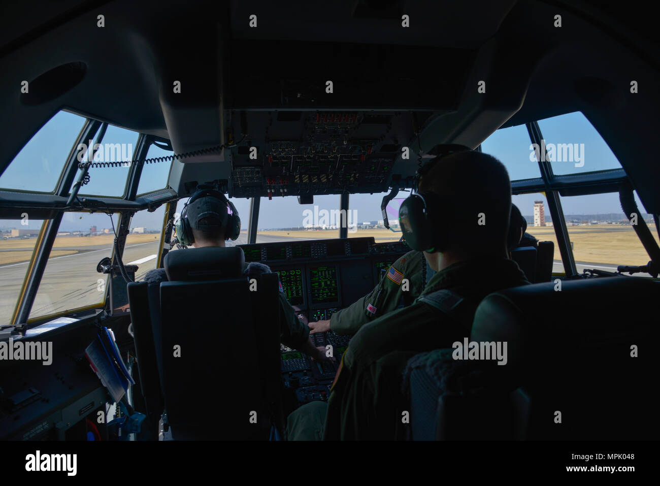Crew members of the 36th Airlift Squadron prepare to take off during the first C-130J Super Hercules training sortie at Yokota Air Base, Japan, March 20, 2017. The C-130J incorporates state-of-the-art technology to reduce manpower requirements, lower operating and support costs, and provide life-cycle cost savings over earlier C-130 models. (U.S. Air Force photo by Staff Sgt. David Owsianka) - Stock Image