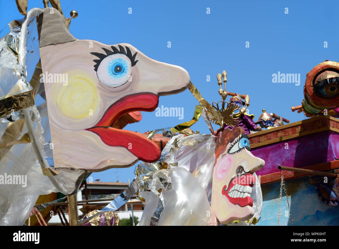 Carnival Float with Stylised Male & Female Faces or Giant Puppets at Spring Carnival Aix-en-Provence Provence France Stock Photo