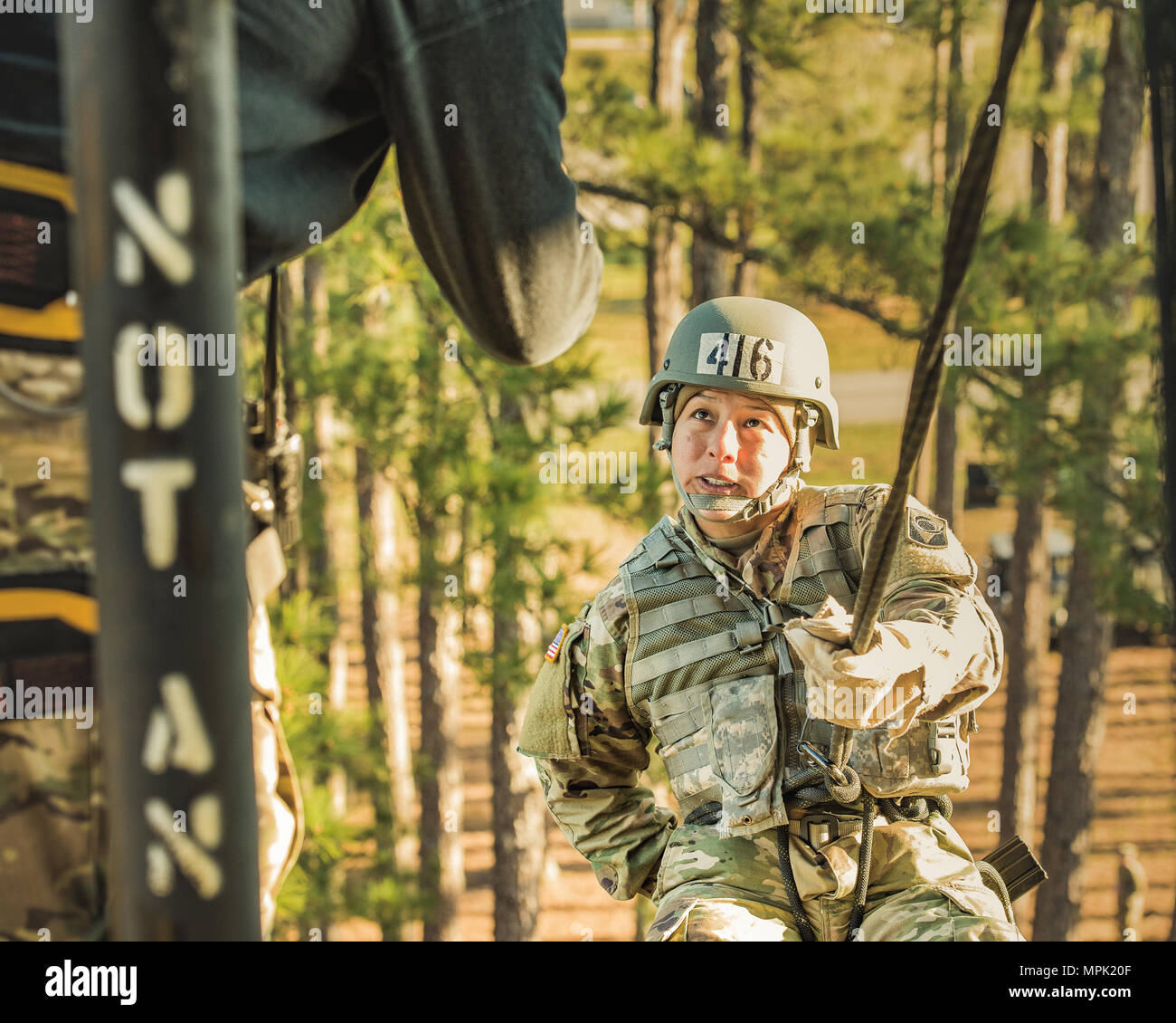 A Soldier prepares to rapel down a tower at Camp Blanding Joint Training Center as part of the AIr Assault Course at Camp Blanding Joint Training Center. - Stock Image