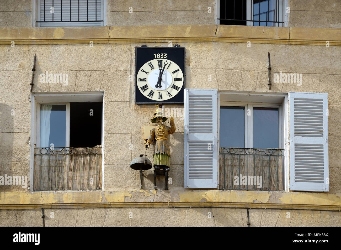 Wall Clock, Automaton Clock or Jacquemart (1833) known as 'La Chinois' or Chinaman on the Place des Precheurs Aix-en-Provence Provence France - Stock Image