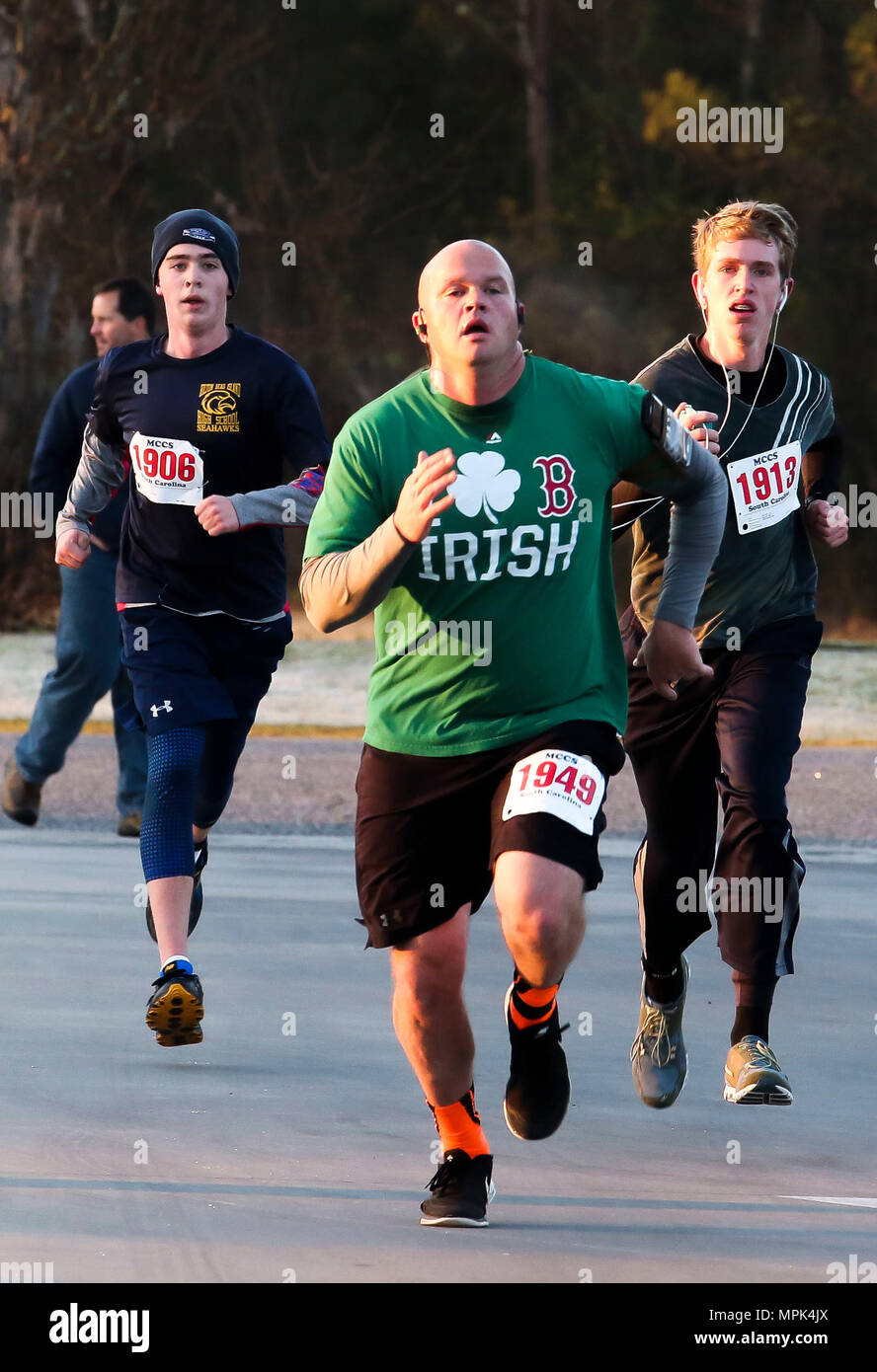 554acf22d Participants sprint down the finish line during a St. Patrick's Day fun run  aboard Marine