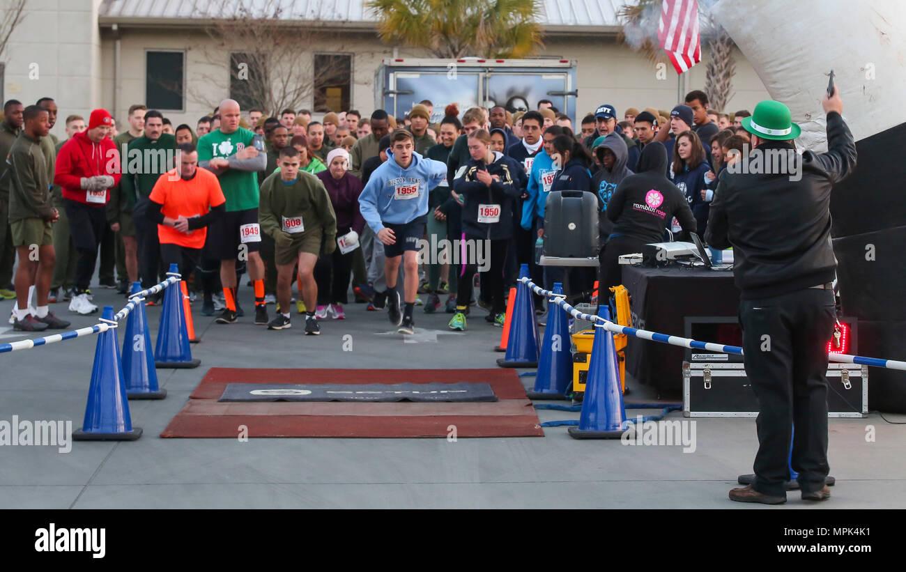 5a516ff95 Participants prepare to participate in a St. Patricks Day fun run aboard  Marine Corps Air