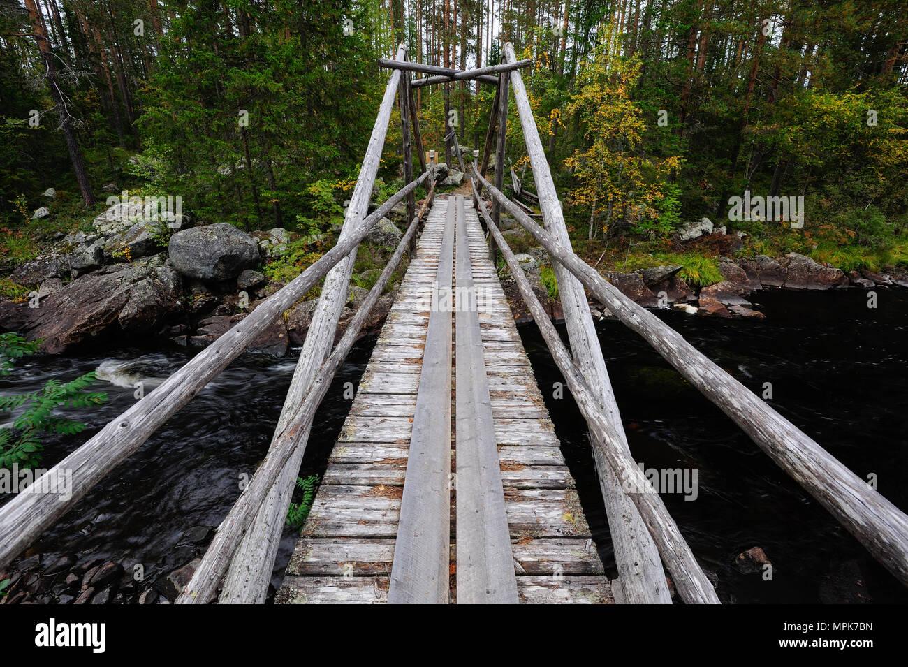 Wood bridge over the wild river, dalarna, sweden - Stock Image