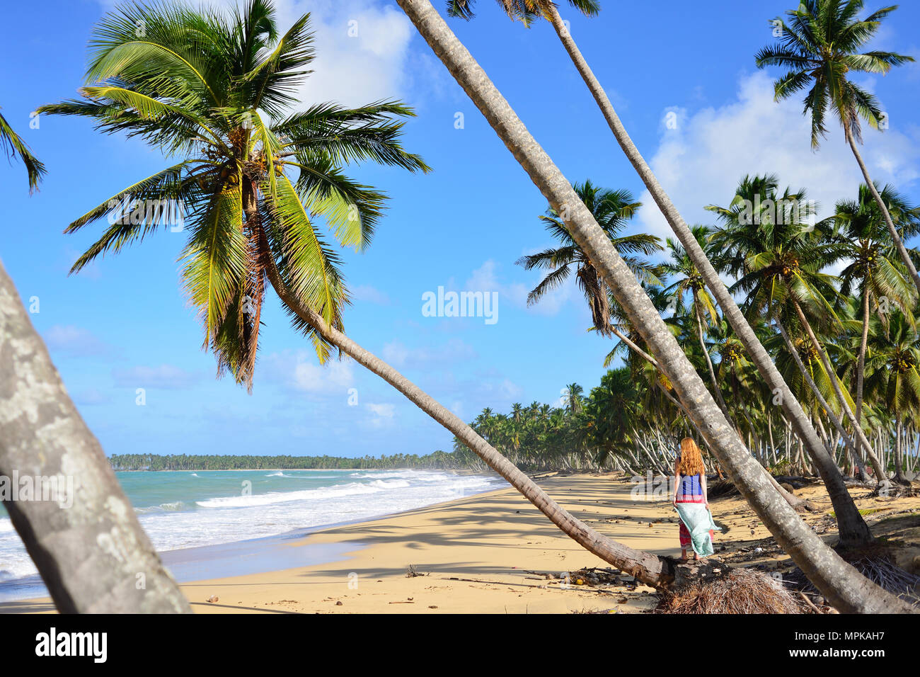 Happy tourist on the Limon beach wild and hard to reach on the south coast of Dominican Republic - Stock Image