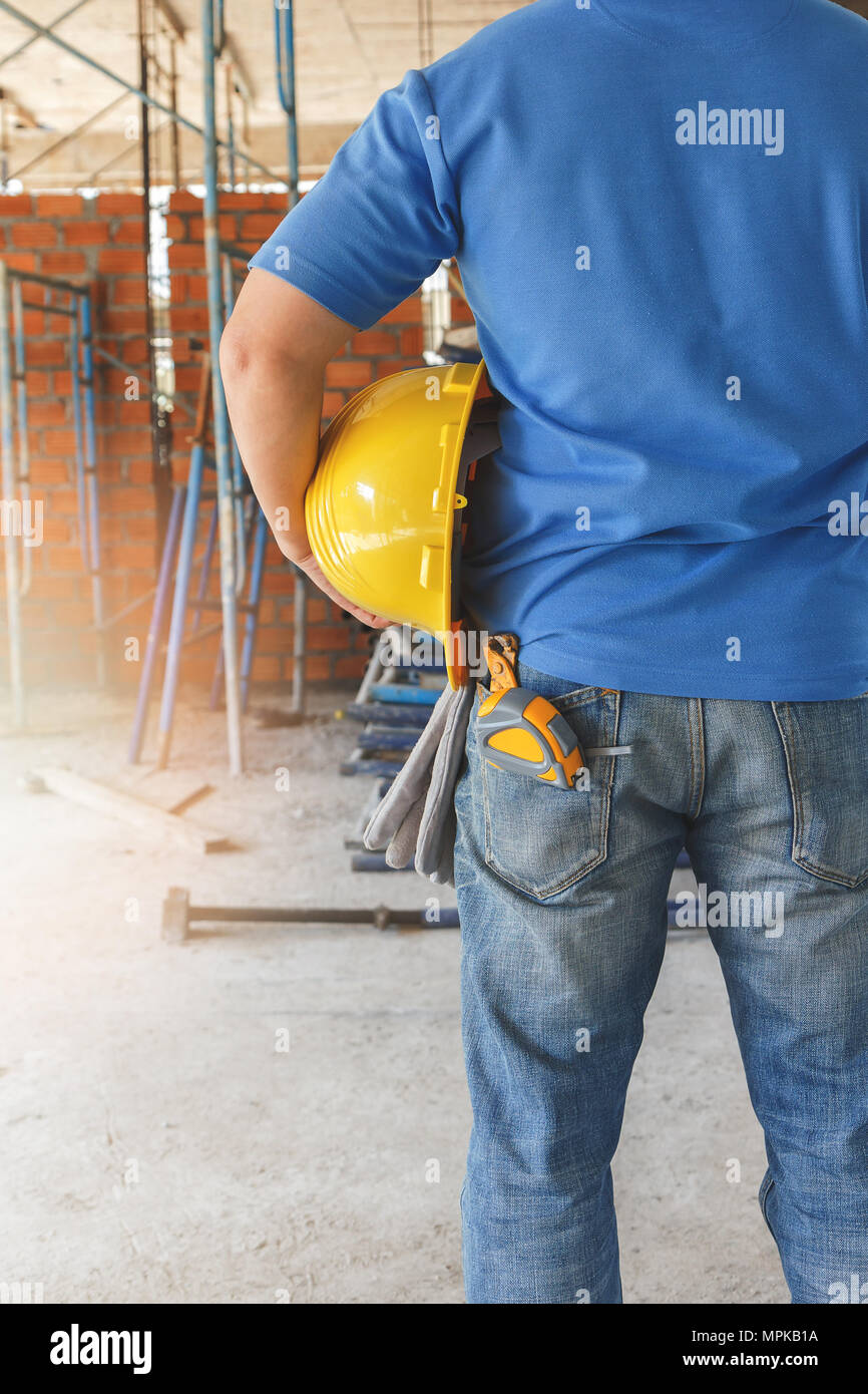 Construction Worker with helmet in building construction site - Stock Image