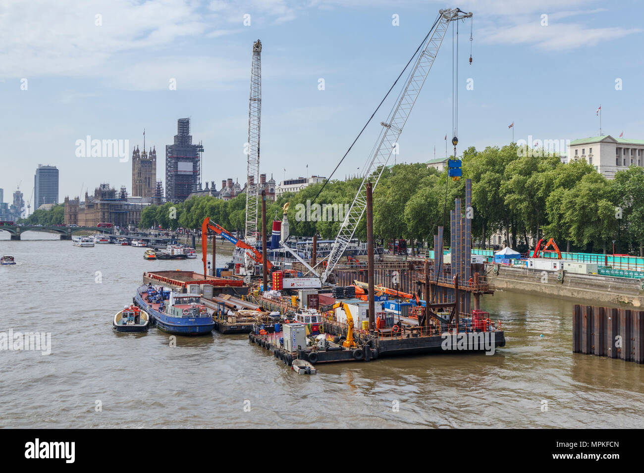 Thames Tideway Tunnel works on Victoria Embankment Foreshore, London SW1, on the River Thames looking towards Westminster - Stock Image