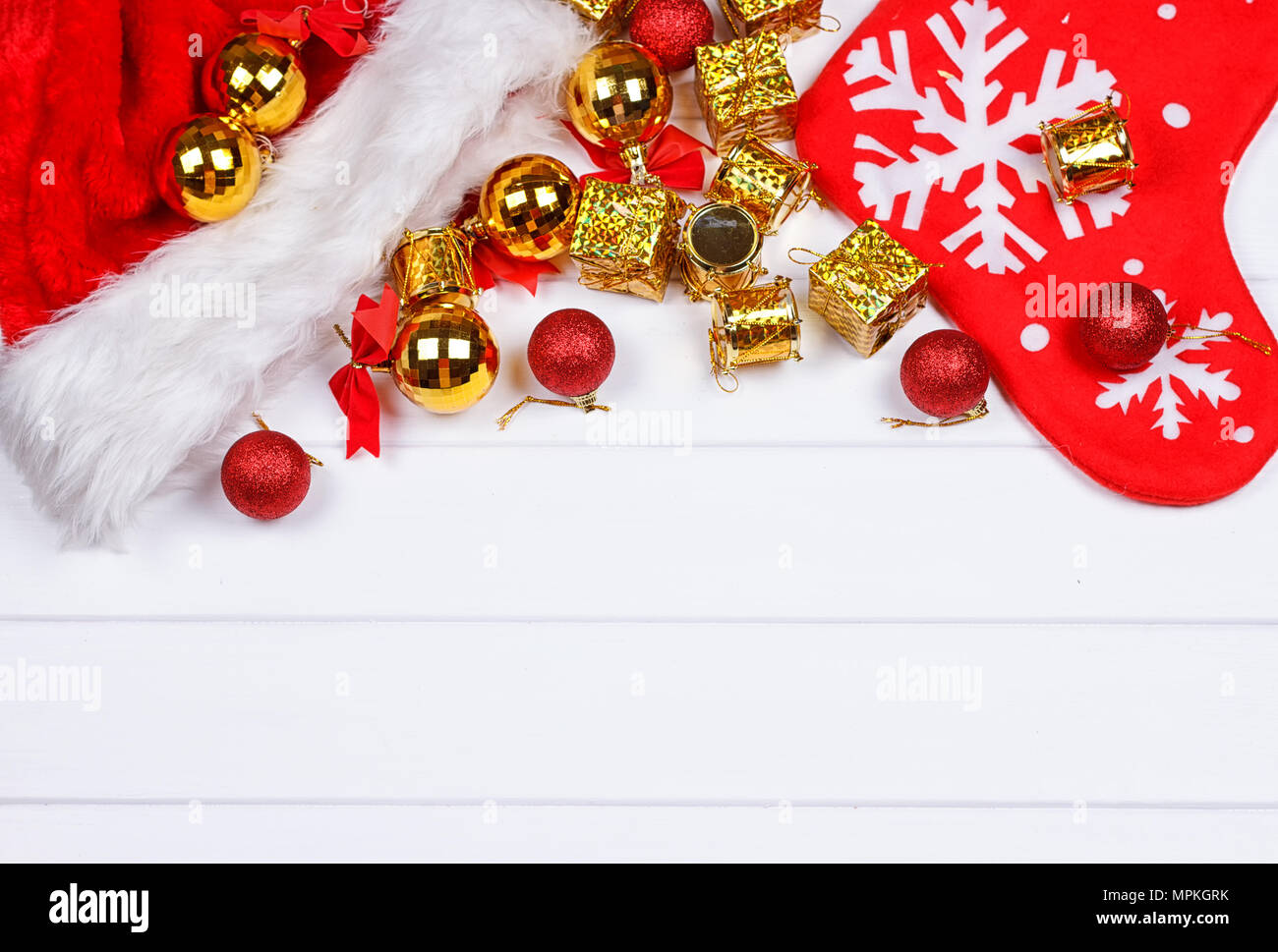 Christmas presents laid on a white wooden table background Stock ...