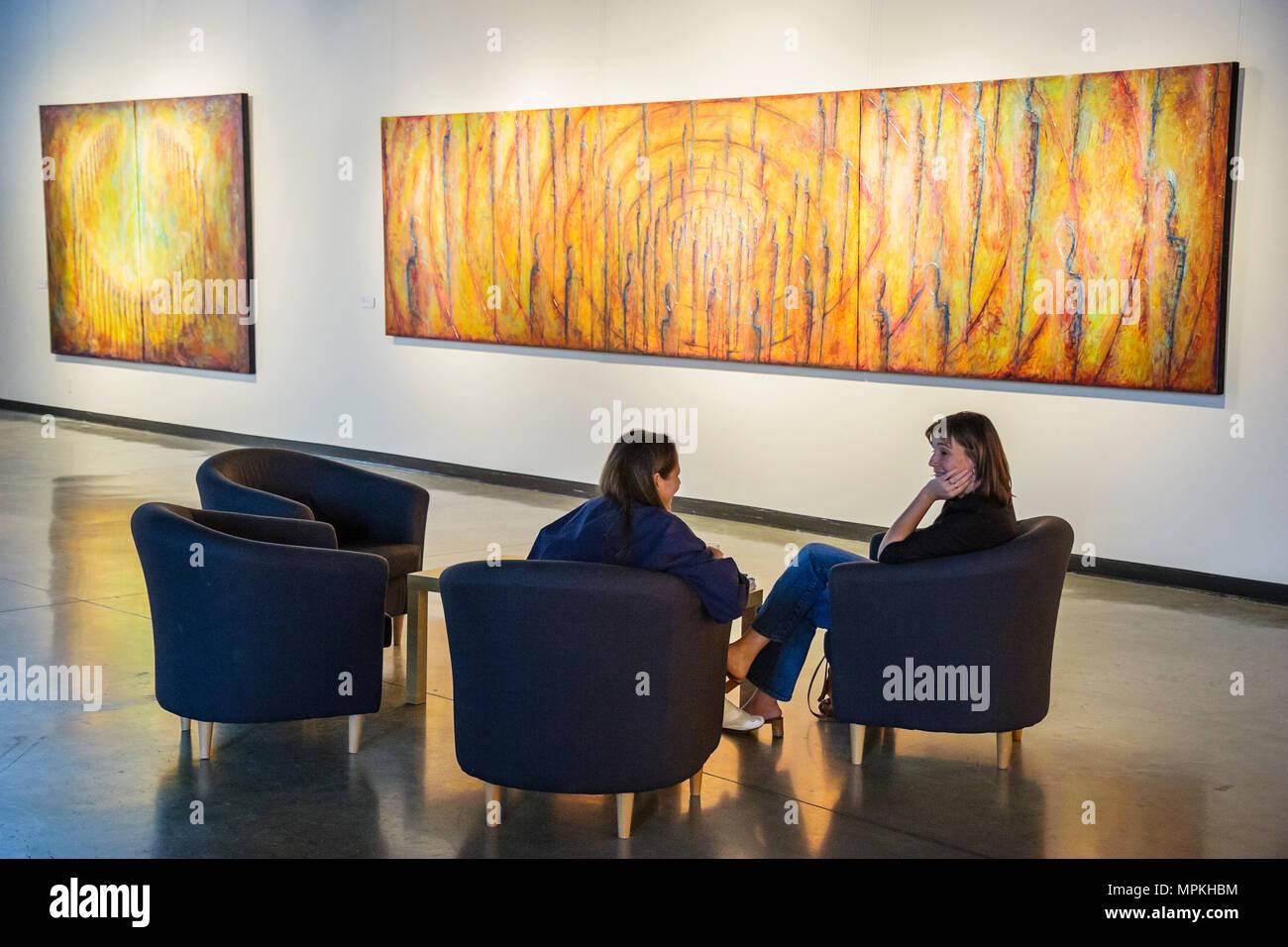 Montreal Canada Saint Michel District Le Pavillon de La Tohu urban green space gallery painting women talk Stock Photo