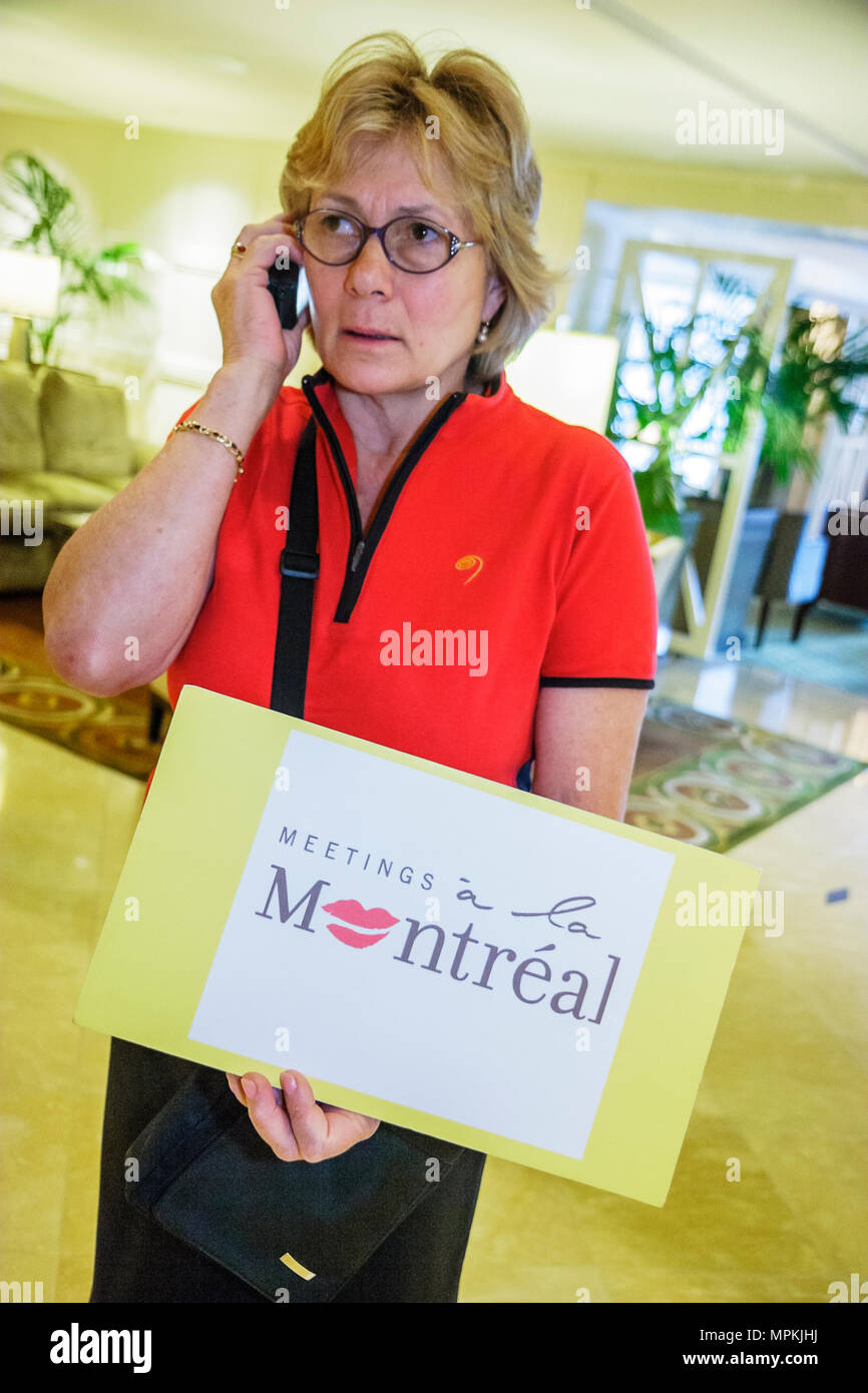 Montreal Canada Fairmont Queen Elizabeth Hotel female guide sign Meetings a la Montreal cell phone - Stock Image