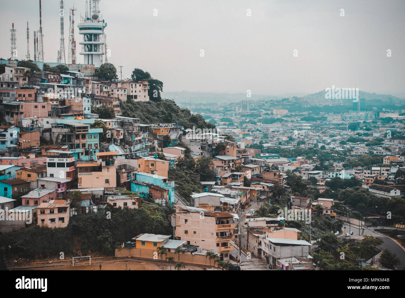 Old meets modern in views from Las Peñas over the colorful houses of Guayaquil, a UNESCO world heritage site in Ecuador's biggest city - Stock Image