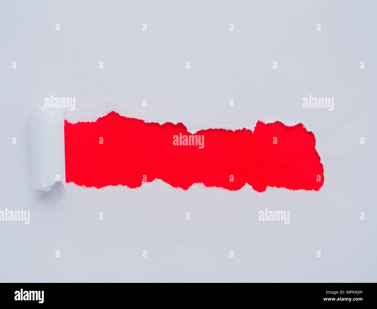 Tearing a white paper frame hole on red background Stock Photo ...