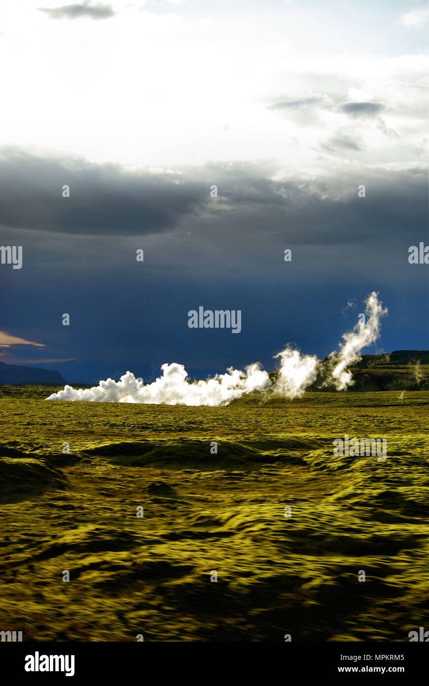Steam and smoke from a geothermal vent, Southern Iceland - Stock Image