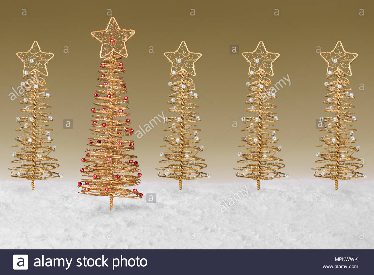 gold wire tree christmas decoration on a fake snow background