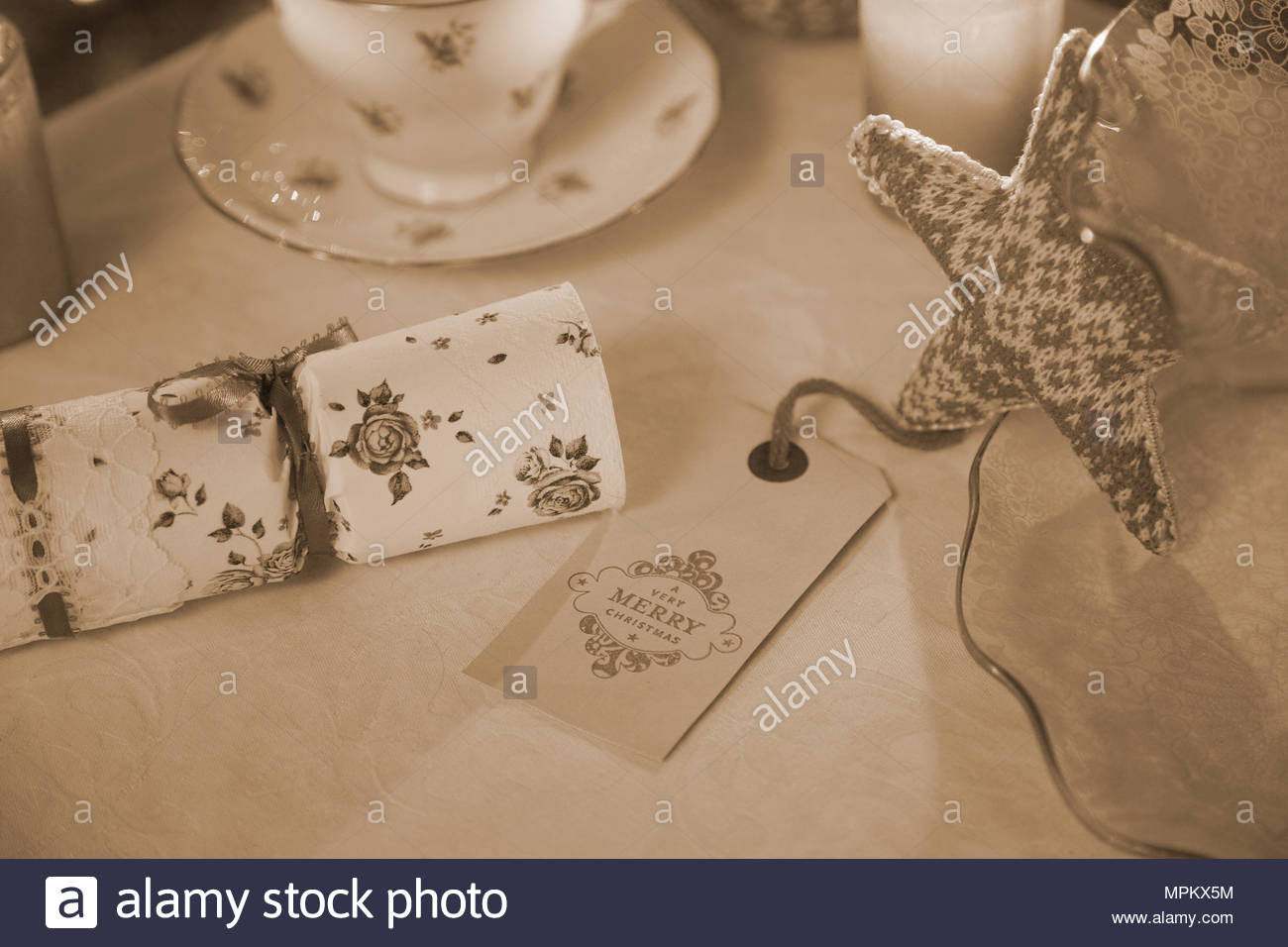 Vintage christmas decorations on a table top with antique baubles