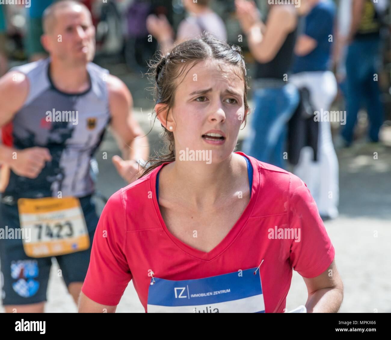 Regensburg, Bavaria, Germany, May 13, 2018: Participant of the Regensburg Marathon 2018 at the old city hall - Stock Image