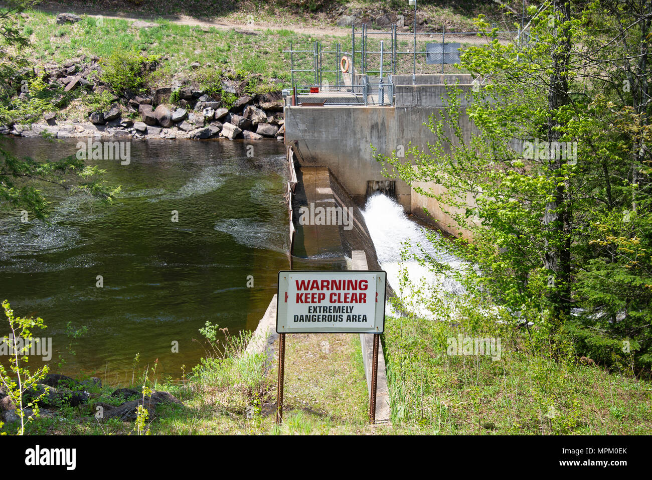 A Warning Keep Clear sign at the Christine Falls Hydroelectric dam in the Town of Wells, NY USA - Stock Image