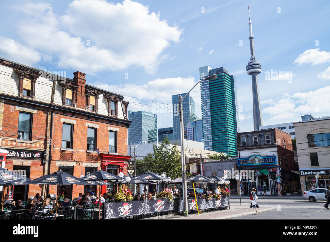 Toronto Canada Ontario Queen Street West trendy neighborhood corner historic building 1886 Black Bull Tavern restaurant student - Stock Image