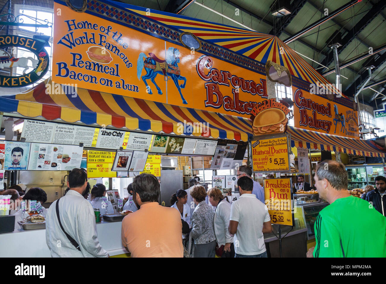 Toronto Canada Ontario St. Lawrence Market shopping vendor merchant Carousel Bakery counter man woman customer sales clerk emplo - Stock Image