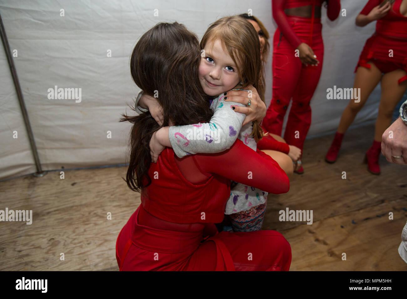 Fifth Harmony Member Lauren Jauregui Hugs A Young Fan During A