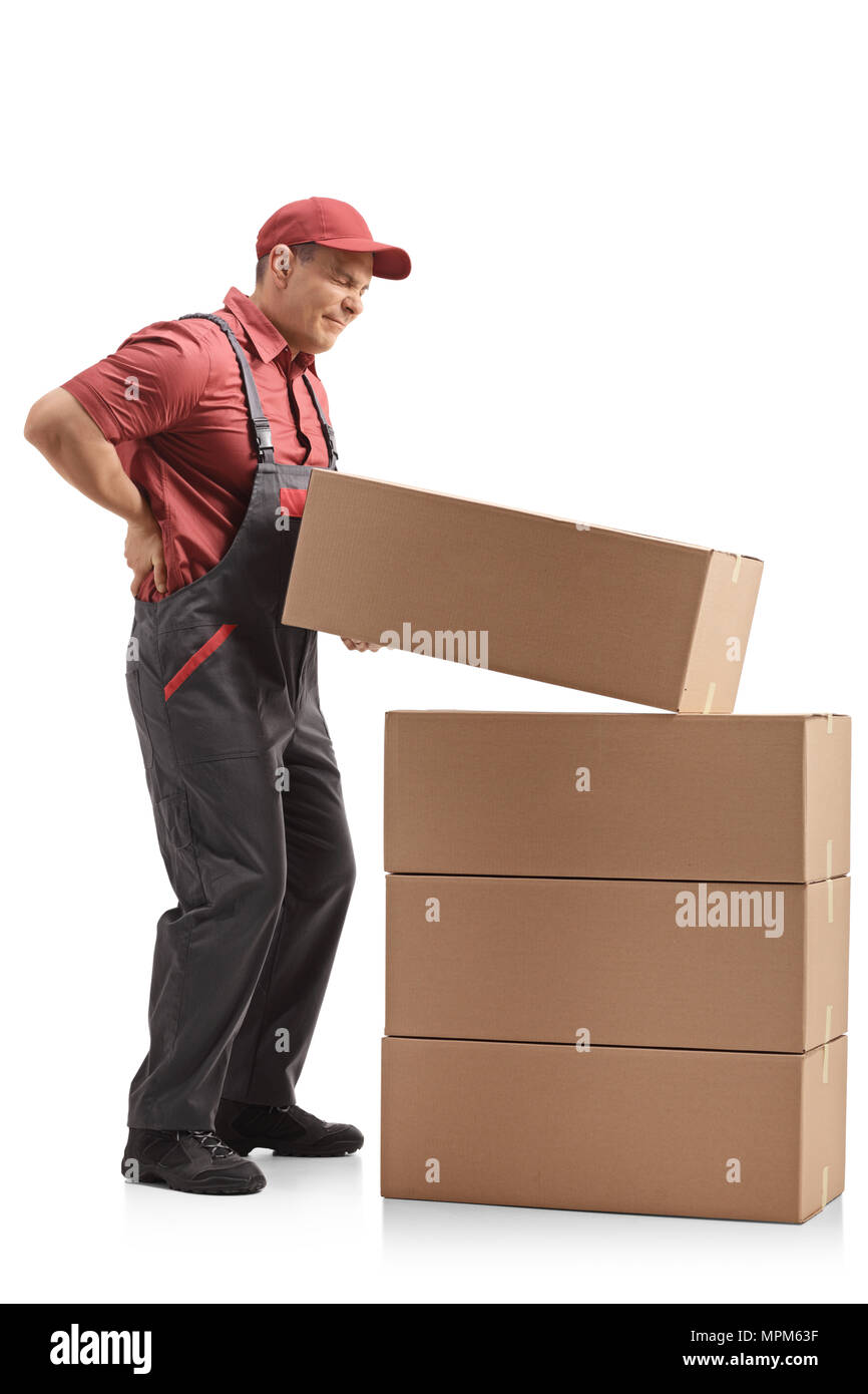 Full length profile shot of a mover lifting a package and experiencing back pain isolated on white background - Stock Image