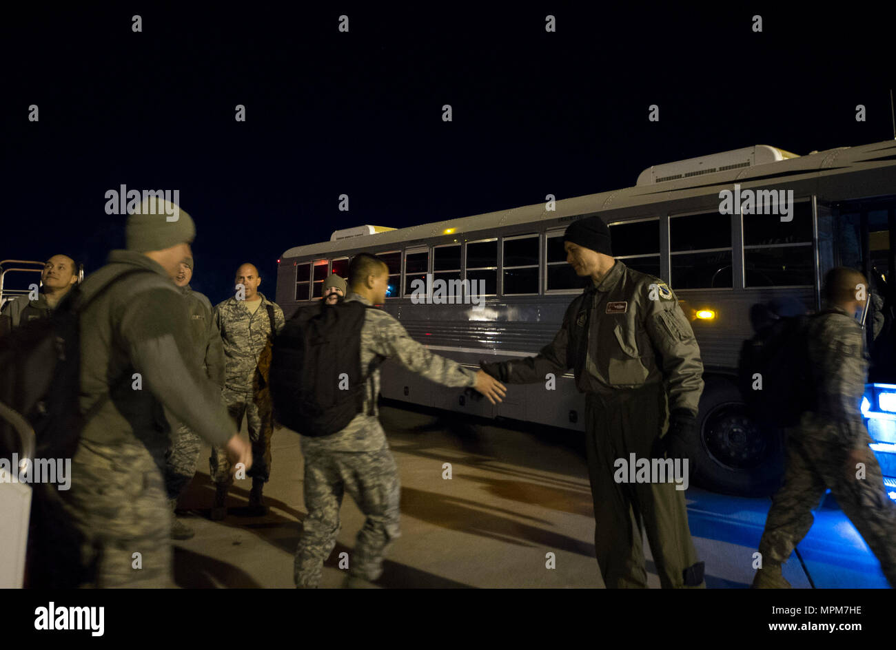 Air Force Lt. Col. David Skalicky, 90th Fighter Squadron commander, greets Airmen after arriving back from Royal Australian Air Force Base Tindal, Northern Territory, Australia, March 18, 2017 at Joint Base Elmendorf-Richardson, Alaska. More than 200 Airmen participated in a bilateral exercise as part of the Enhanced Air Cooperation initiative. (U.S. Air Force photo by Staff Sgt. Sheila deVera) - Stock Image