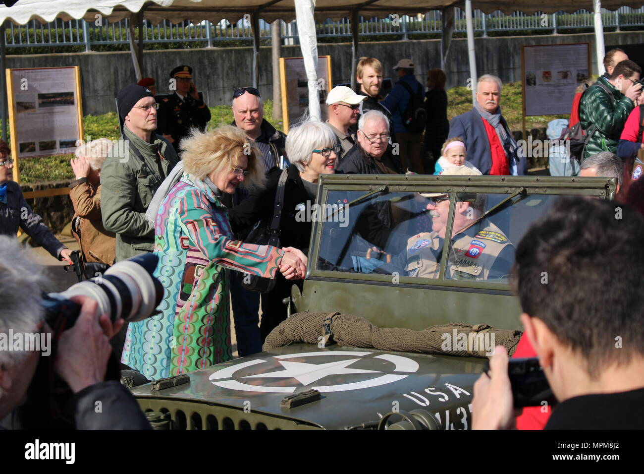 Catherine Rommel, left, the granddaughter of German Field Marshall Erwin Rommel, and Helen Patton, the granddaughter of U.S. Army Gen. George Patton, greet reenactors along the Rhine River Saturday, March 24, 2017 in Nierstein Germany. Americans and Germans gathered for the dedication ceremony for a monument to the 249th Engineer Combat Battalion's efforts at the end of World War II, building a bridge across the river near Nierstein during an operation that helped shorten the war.  (Photo by Lt. Col. Jefferson Wolfe) - Stock Image