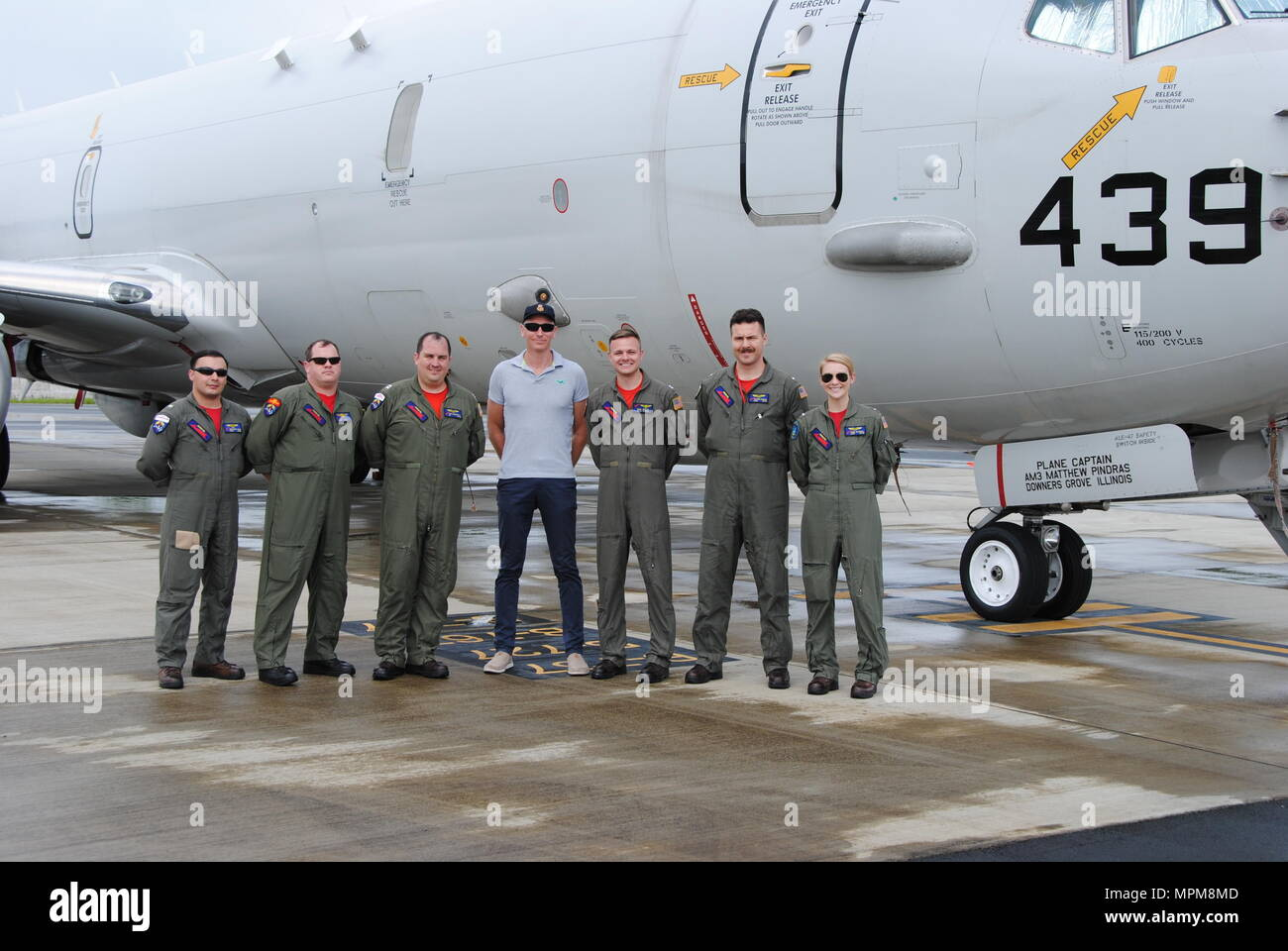 KOROR, Palau (March 11, 2017) The Red Lancers of Patrol Squadron Ten (VP-10) pose in front of the P-8A with their Maritime Surveillance Coordinator after arriving on detachment in Palau. The Red Lancers flew to Palau to participate in Rai Balang, a Forum Fisheries Agency operation that conducted surveillance missions to deter illegal fishing in their national waters and Exclusive Economic Zone (EEZ).  (U.S. Navy photo by Mass Communications Specialist 3rd Class Nathan Morin/Released) - Stock Image
