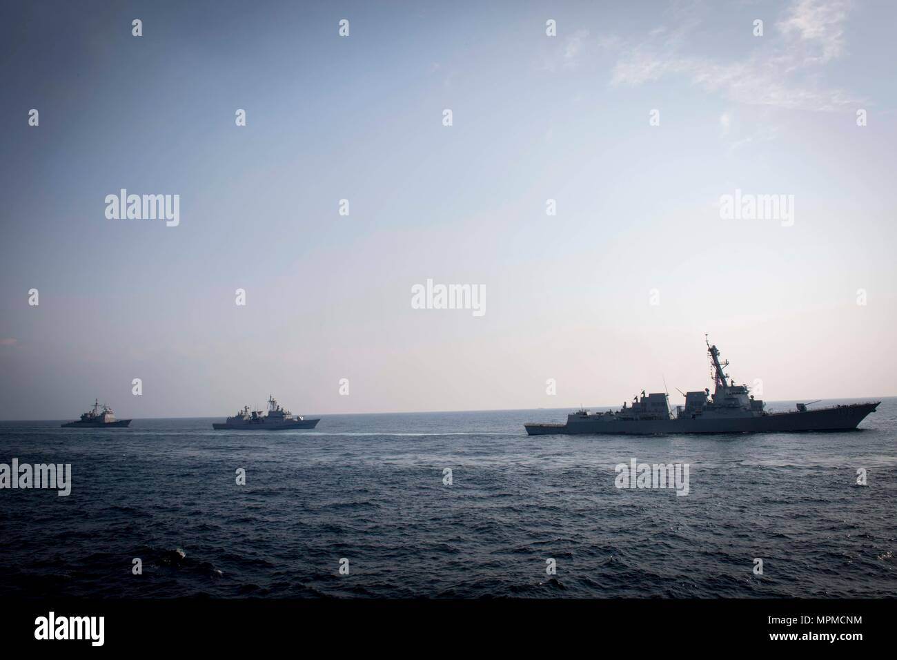 WATERS EAST OF THE KOREAN PENINSULA (March 22, 2017) The Arleigh Burke-class guided-missile destroyer USS Wayne E. Meyer (DDG 108), the Republic of Korea Navy destroyer ROKS Gwanggaeto the Great (DDH 971), and USS Mitscher (DDG 57) steam behind USS Stethem (DDG 63) as the ships participate in surface maneuvers with several other U.S. and Republic of Korea Navy ships and submarines during Foal Eagle (FE) 17. FE 17 is a series of annual training events designed to increase readiness to defend the ROK, protect the region, and maintain stability in the Korean Peninsula. (U.S. Navy photo by Mass Co - Stock Image