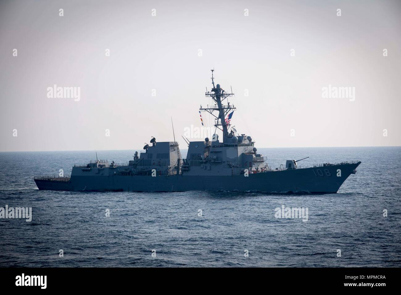WATERS EAST OF THE KOREAN PENINSULA (March 22, 2017) The Arleigh Burke-class guided-missile destroyer USS Wayne E. Meyer (DDG 108) steams behind USS Stethem (DDG 63) as the ships participate in surface maneuvers with several other U.S. and Republic of Korea Navy ships and submarines during Foal Eagle (FE) 17. FE 17 is a series of annual training events designed to increase readiness to defend the ROK, protect the region, and maintain stability in the Korean Peninsula. (U.S. Navy photo by Mass Communication Specialist 2nd Class Ryan Harper/ Released) - Stock Image