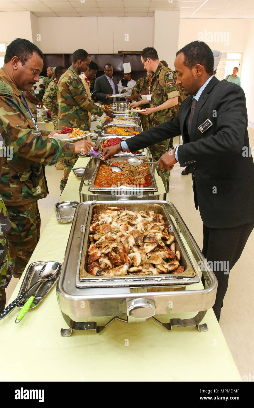 Caterers from the Ambassador Hotel provide meals for nearly 100 participants during the USARAF-led exercise Justified Accord 17, March 20-24, 2017, at the Peace Support Training Center in Addis Ababa, Ethiopia. JA17 is an annual weeklong joint exercise that brings together U.S. Army personnel, African partners, allies and international organizations to promote interoperability between participating nations for peacekeeping operations in the East Africa region. (U.S. Army Africa photo by Staff Sgt. Lance Pounds) - Stock Image