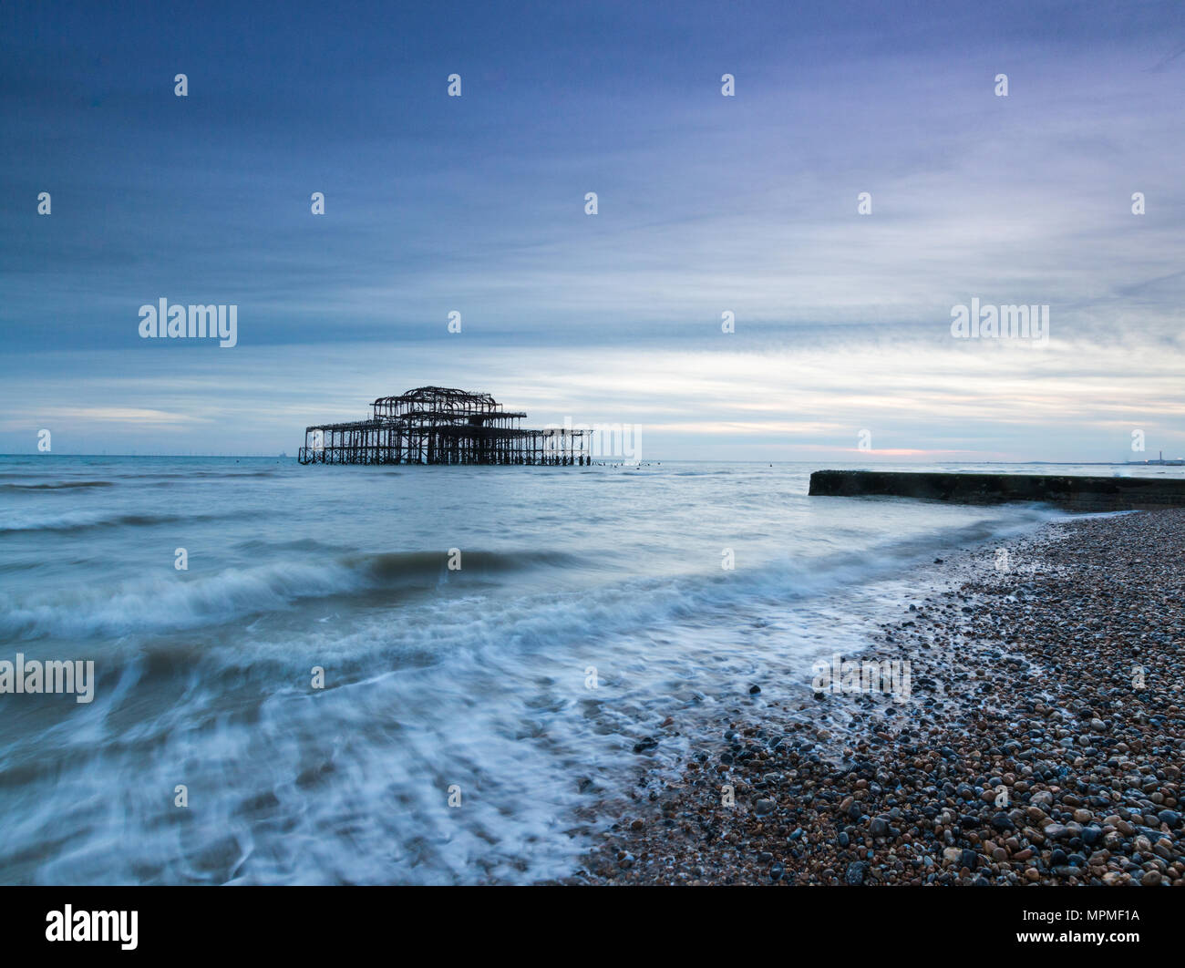 View of Old Brighton Pier from the pebble beach Stock Photo