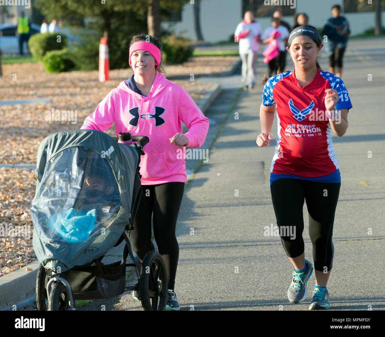 Stroller Warrior Moms take on the 2.5 mile long Air Force Assistance Fund fun run, Mar. 27,2017, Travis Air force Base, Calif. More than 200 people participated in the event which was held to raise awareness about the AFAF mission; supporting Air Force families in need, covering active duty, retirees, reservists, guard, dependents, and surviving spouses.(U.S. Air Force photo/ Heide Couch) - Stock Image