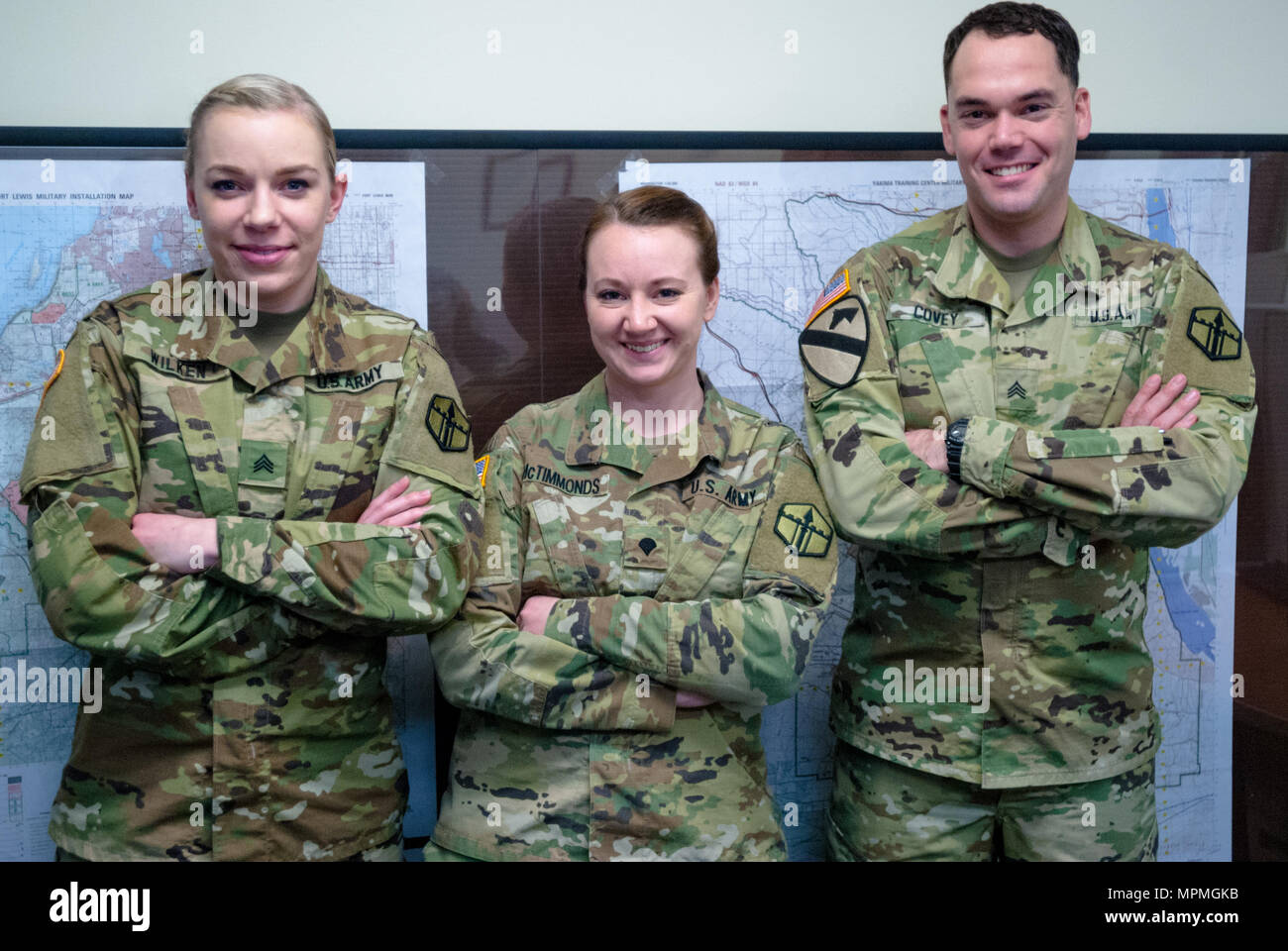 From left: Sgt. Morgan T. Wilken, Spc. Tara M. McTimmonds, Sgt. Noel A. Covey, pose for a photograph at 301st Maneuver Enhancement Brigade (MEB) headquarters, Joint Base Lewis-McChord, Wash. February 12, 2017. Geospatial engineers produce the maps that will support the commander's next mission, and are a vital component of the Army, Army Reserve, and Total Force (U.S. Army Reserve photo by Spc. Sean Harding/Released). - Stock Image
